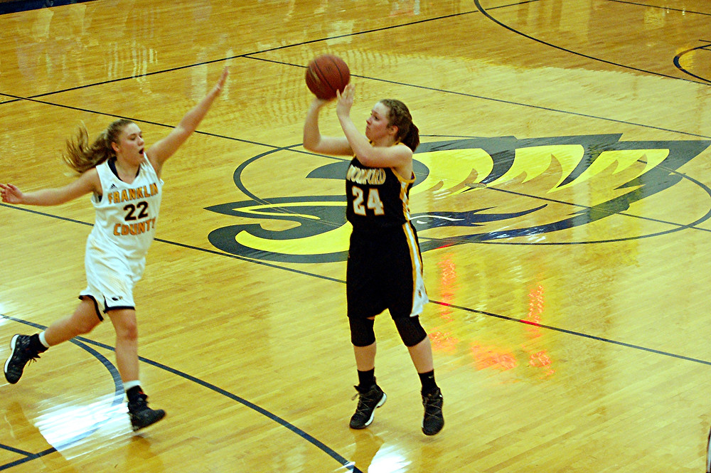 ABBY MOFFETT scored 12 points – all on three-pointers – for Woodford in its road game against Franklin County on Friday, Jan. 13. While the Lady Jackets played better against the Lady Flyers in this game than in their first meeting this season, Franklin County won the game 63-38. (Photo by Rick Capone)