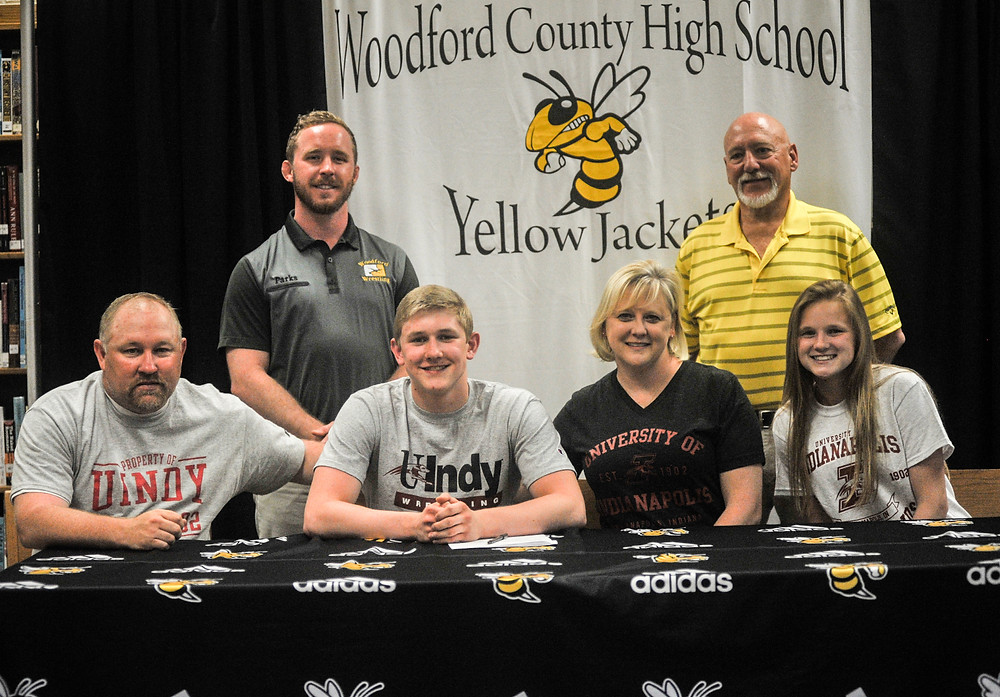 WCHS SENIOR TYLAN TUCKER signed his letter of intent with the University of Indianapolis on Monday, May 14. Pictured from left, front : father, Robert Tucker, Tylan, mother Robin Tucker and sister Mackenzie Tucker. Back row: WCHS Coach Rusty Parks and Bill Barrows. (Photo by Bill Caine)