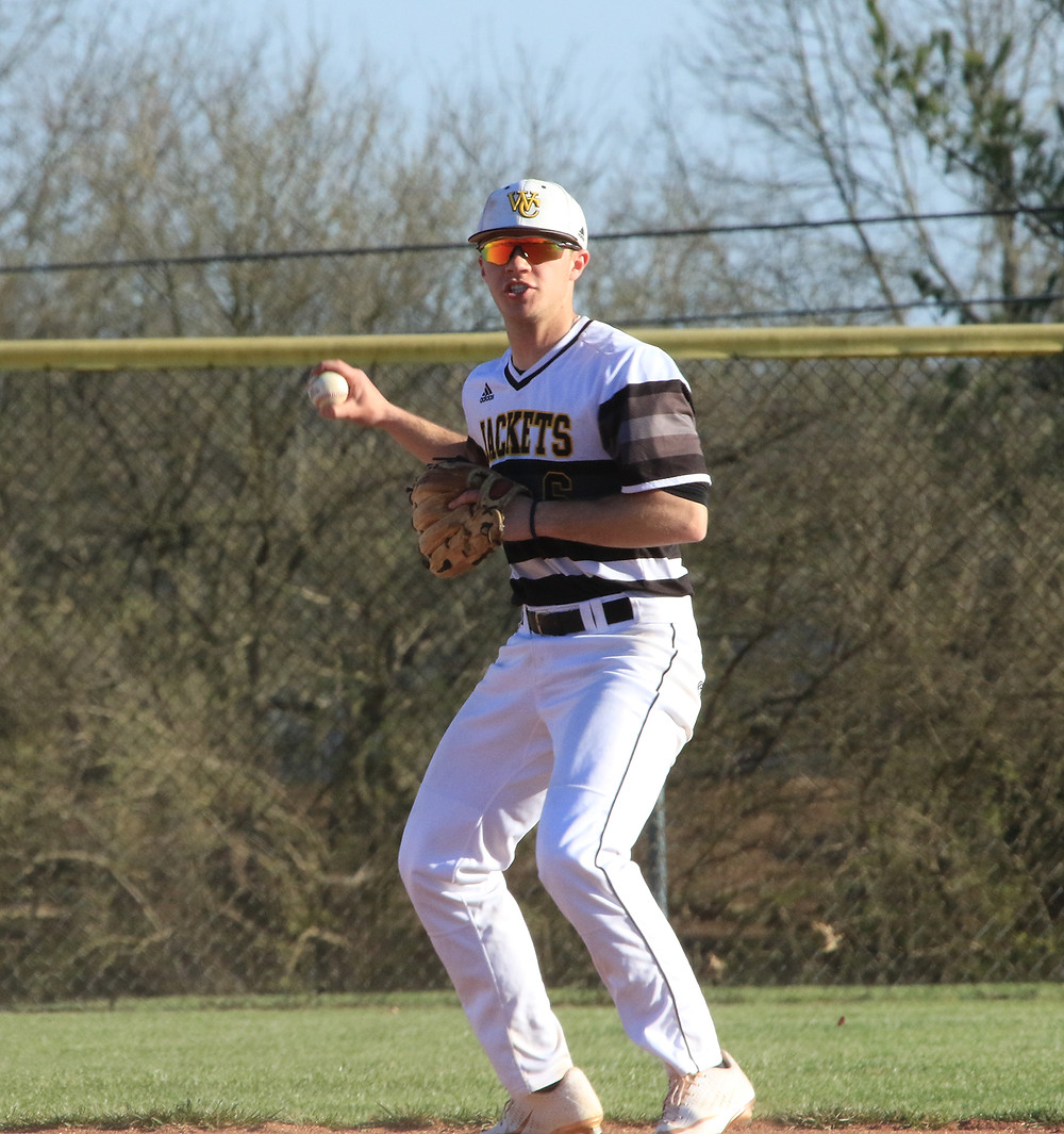 BEN BROWNING SETS HIMSELF for a throw to first base in an early season matchup with Lexington Catholic. Browning was second on the team in total hits. He is one of several seniors Woodford County will need to replace in 2020. (Photo by Steve Blake)