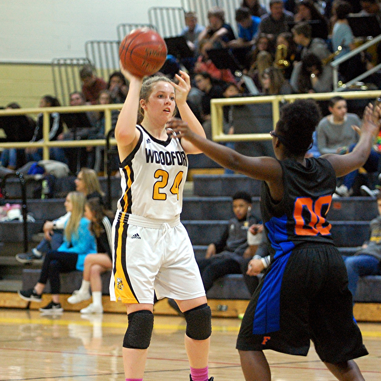 """ABBY MOFFETT looks for a teammate to pass the ball during the Woodford County High School girls' basketball game against Frankfort at home in The Hive on Saturday, Jan. 28. Moffett, who had 19 points, seven rebounds, five assists and four steals in the Lady Jackets' 60-40 win, """"…played her best game of her career,"""" according to Woodford head coach Jay Lucas. (Photo by Rick Capone)"""
