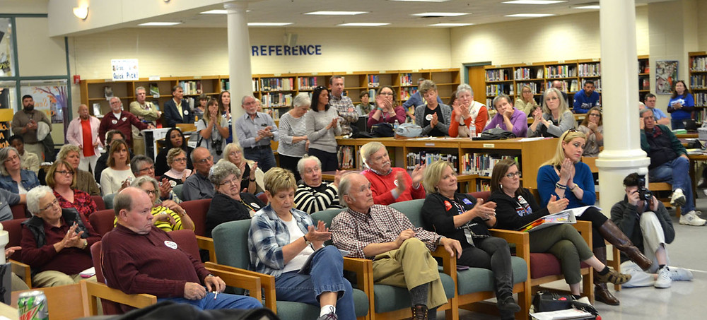 TEACHERS, RETIREES joined state and county employees in the library at Woodford County High School during a pension rally last Thursday afternoon, Oct. 26. (Photo by Bob Vlach)