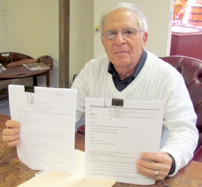 DON VIZI, executive director of the Woodford County Chamber of Commerce, shows some of the paperwork sent to the state for the successful recertification of Woodford County as a Kentucky Work Ready Community. The pile of supporting documents is about two inches thick, he said. (Photo by John McGary)