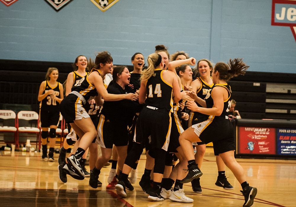 THE LADY JACKETS basketball team celebrates after Nia Jaco made the game winning free throws to beat West Jessamine, 70-69 on Friday, Dec. 15. See story on pg. 13. (Photo by Bill Caine)