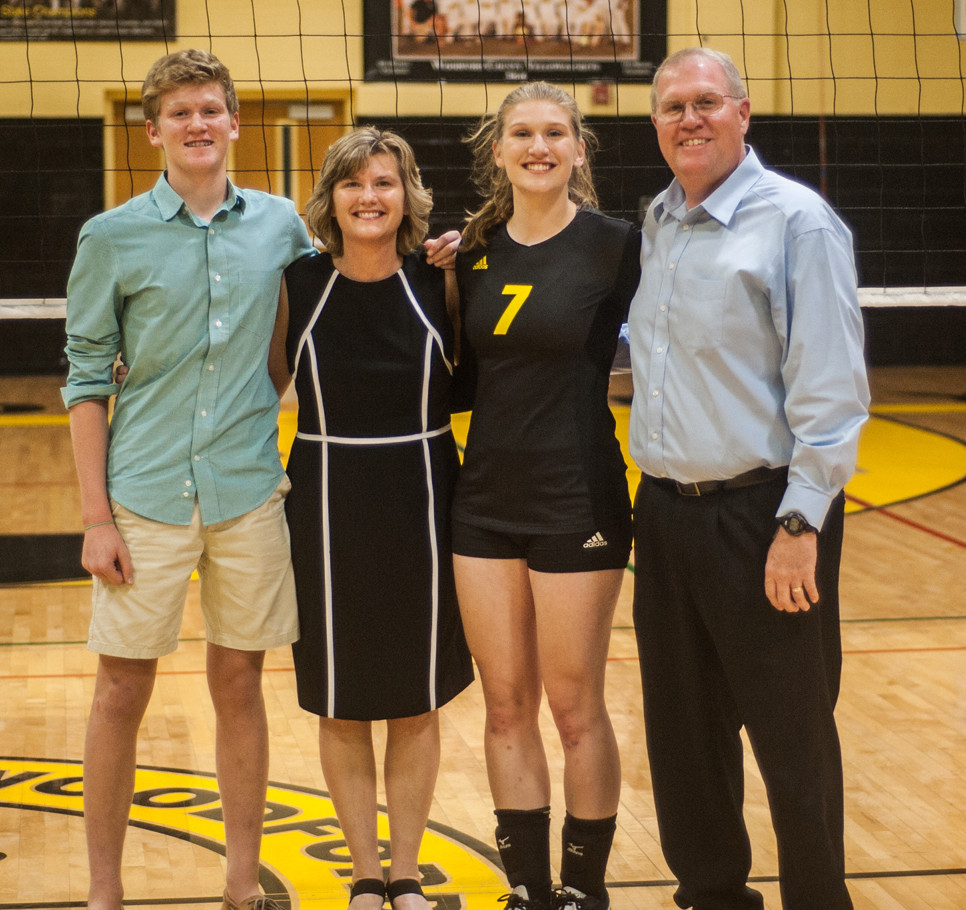 "VOLLEYBALL SENIOR NIGHT was held Oct. 4 in ""The Hive"" as the Lady Jackets defeated Frankfort 3-0. Senior Lauren Smiley was honored with her family before the game. From left are Will Smiley, Darlene Smiley, Lauren Smiley and Jeff Smiley. (Photo by Bill Caine)"