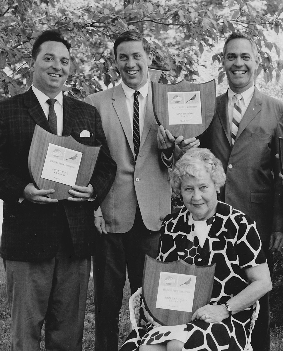 HAYWOOD ALVES, left, Ben Chandler, Moss Vance and Mildred Chandler display citations awarded by the Kentucky Press Association in 1967. (Woodford Sun photo)