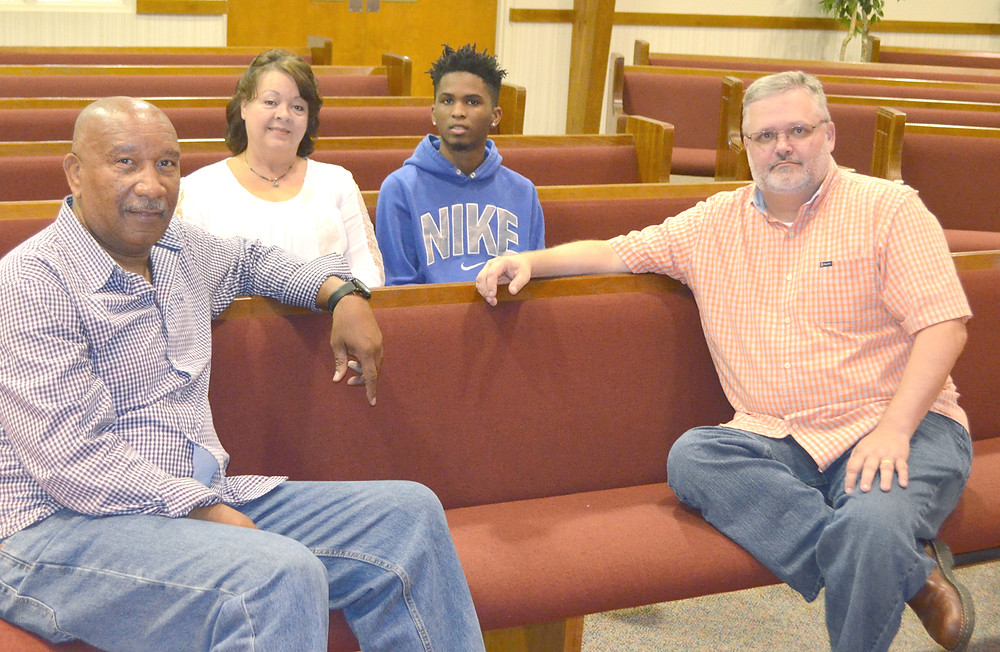 OVERCOMERS CHURCH pastors Larry Blackford, left, and Mark Routt, right, will have their first Sunday evening service at Huntertown Church of the Nazarene on Oct. 1 at 6. Also pictured are Beth Ellenberg, pastor at Huntertown Church of the Nazarene, and Routt's 20-year-old son, Caleb. (Photo by Bob Vlach)