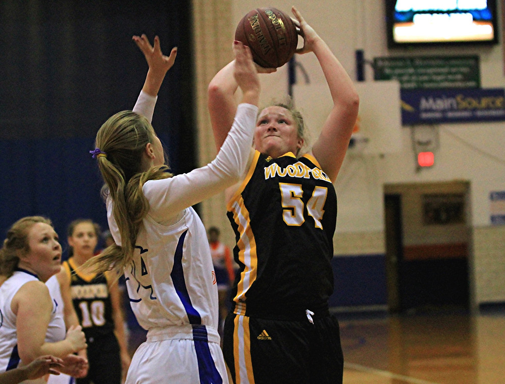 DELANEY ENLOW scored two of her 11 points on this shot during the Woodford County High School girls' basketball district win, 56-50, over Frankfort on Friday, Jan. 6. The freshman finished the game with a triple double. Along with her 11 points, she had 19 rebounds and 10 blocked shots. (Photo by Steve Blake/multiexposures.com)