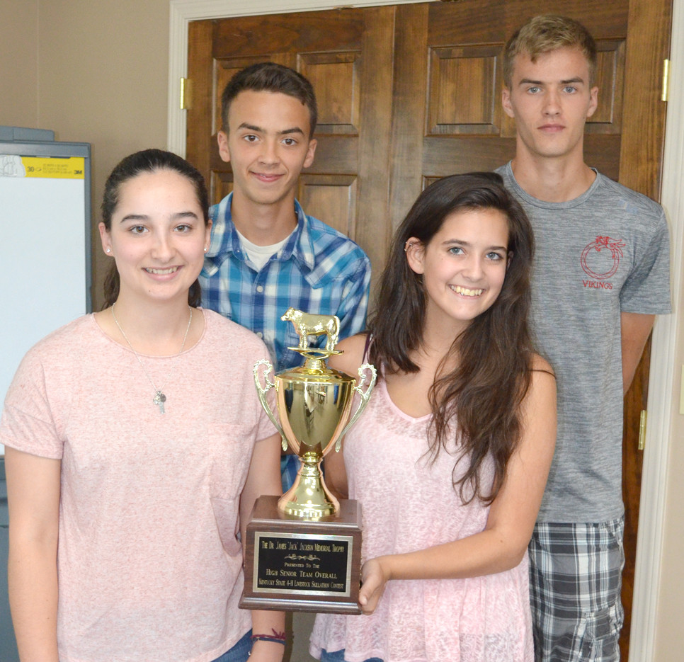 A SENIOR 4-H SKILLATHON TEAM representing Woodford County won a state championship to advance to nationals in November. From left, front, are Eliza Lavin and Chloe Wagener; back, Cole Vanzant and Matt Vanzant, with their state title trophy. (Photo by Bob Vlach)
