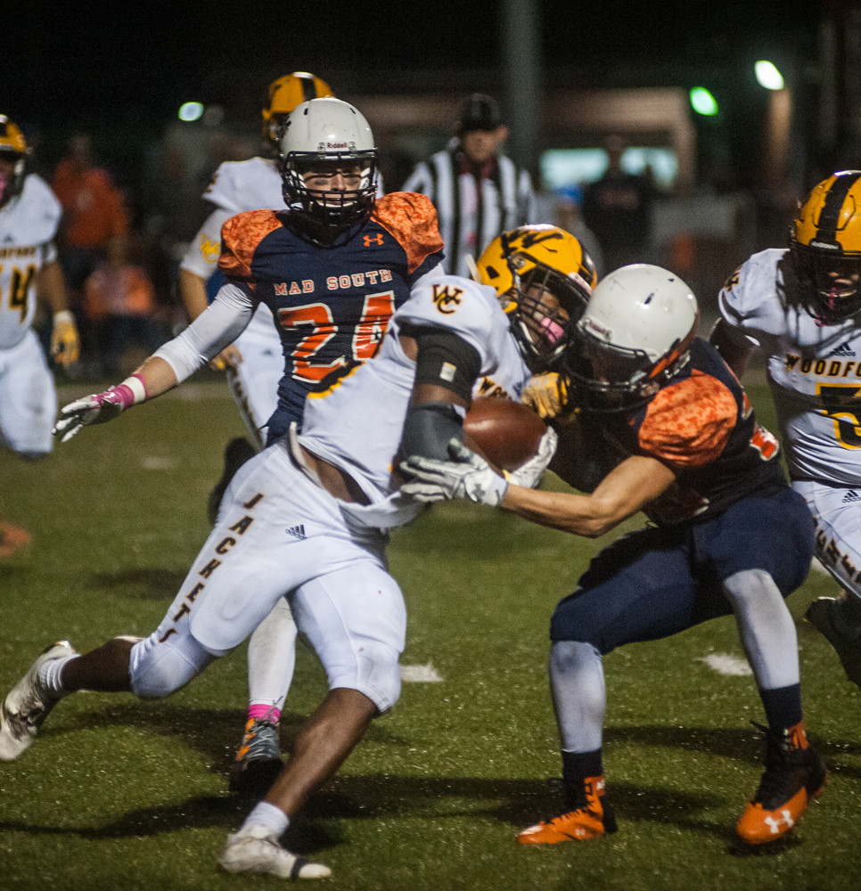 BRENNAN CLARK fights his way through a Madison Southern defender. The Eagles defeated the Jackets 41-10 in the game played on Oct. 13. (Photo by Bill Caine)