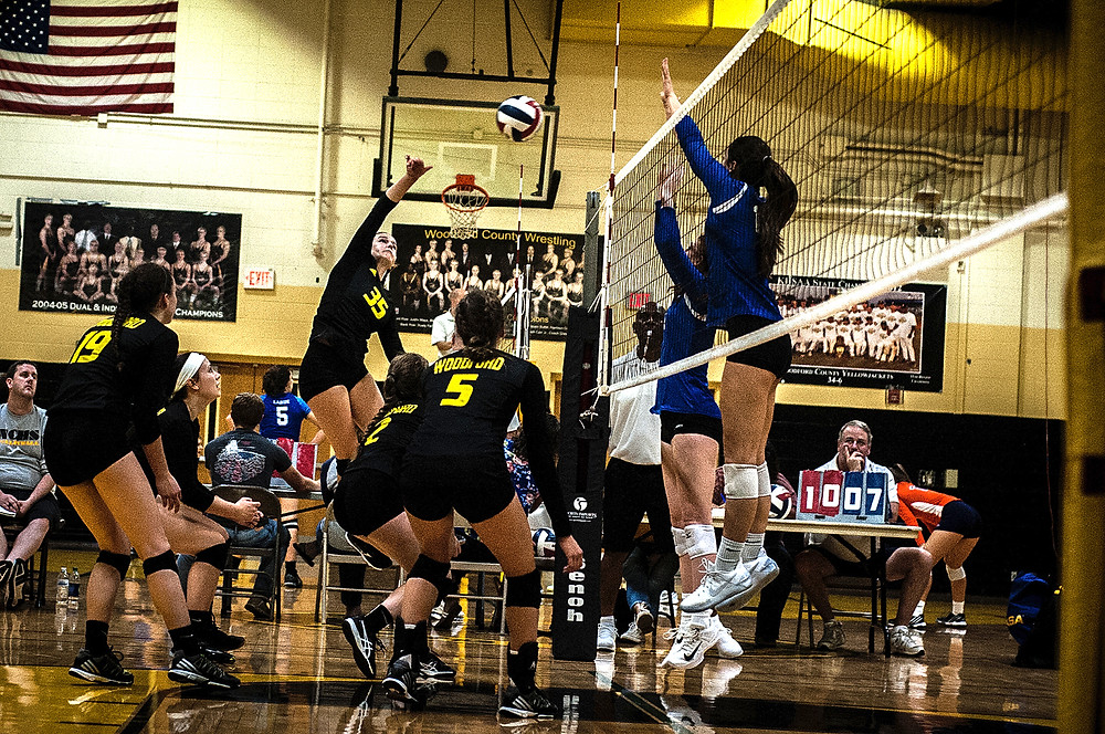 CLAIRE LEHMKUHLER attempts a kill in the championship game of the Woodford County Invitational tournament. (Photo by Bill Caine)