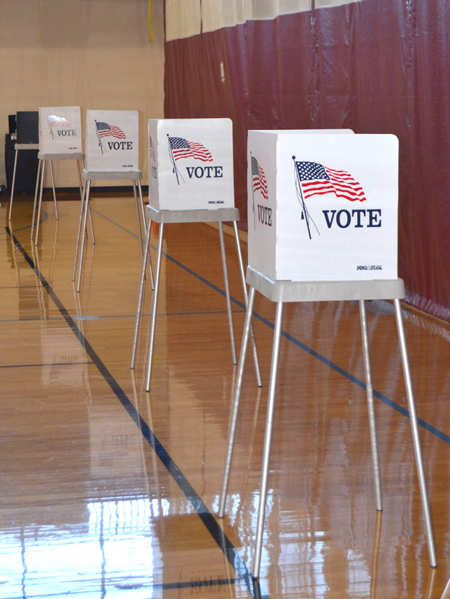"""WOODFORD COUNTY VOTERS had numerous stations for voters on Election Day, Tuesday, Nov. 4. A voter entering Falling Springs Arts and Recreation Center asked a person leaving, """"Does it take very long?"""" The answer: """"Not at all."""" (Photo by Bob Vlach)"""