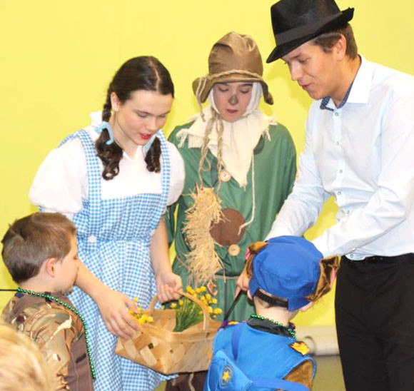 """A TRICK OR TREAT TRAIL on Oct. 29 supported the Woodford Theatre Young Artists' planned trip to New York City and their participation in Voices on Broadway. From left are Rylie Sudduth (Dorothy), Nate Krohmer (Scarecrow) and Clay Zander (Ryan from """"High School Musical"""") on the Trick or Treat Trail. (Photo submitted)"""