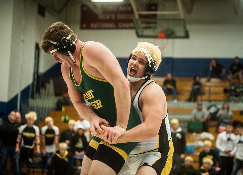 WCHS SENIOR JACK HILL attempts to lift Saint Xavier's Denis Diemer in a heavyweight matchup at the state duals championship on Jan. 27. at Lindsey Wilson College. (Photo by Bill Caine)