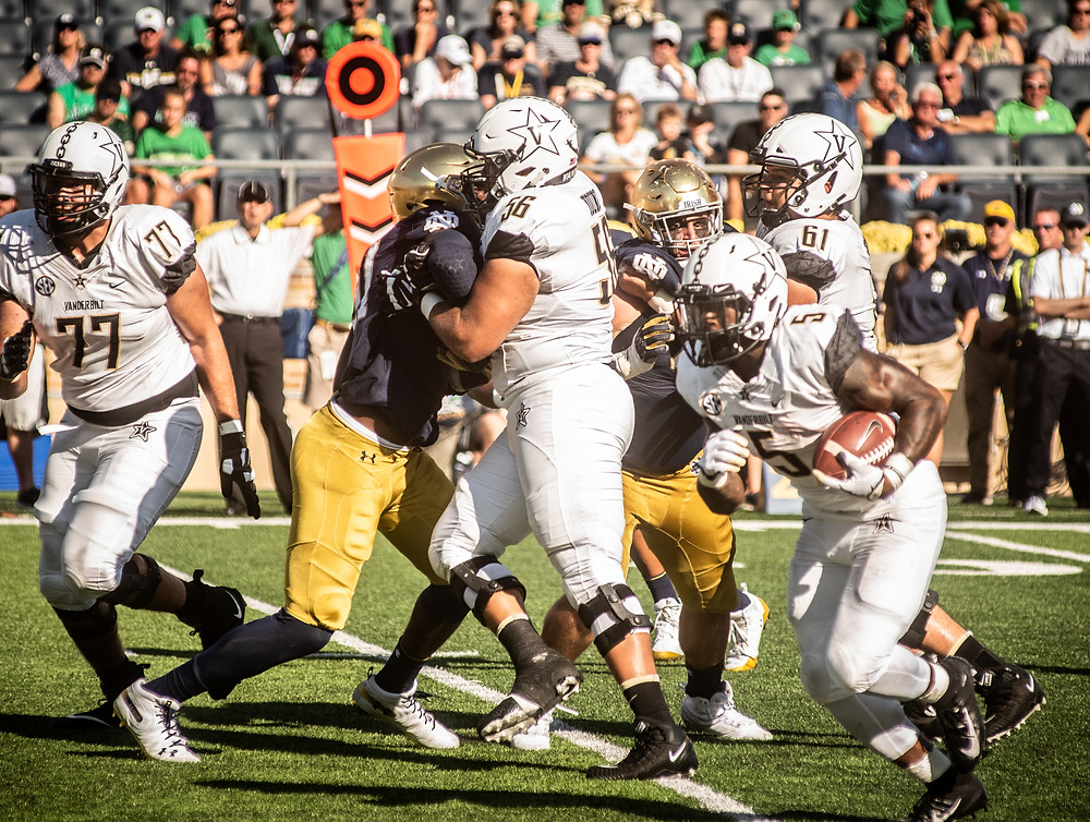 VANDERBILT UNIVERSITY LINEMAN SAIGE YOUNG (56) blocks a Notre Dame defender Saturday, Sept. 15 at Notre Dame Stadium. (Photo by Bill Caine)