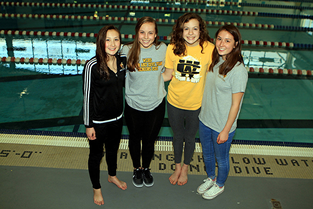 SUPER-SISTERS RELAY TEAM. Two pairs of sisters have dominated the girls' 400-yard freestyle relay this season for the Woodford County High School women's swim team. To date, the sisters won seven out of eight races they have participated in together. The WCHS 400-yard freestyle relay team swimmers are, from left, Katie Gatewood, Mary Crutchfield, Laura Crutchfield, and Maddie Gatewood. (Photo by Steve Blake/multiexposures.com)