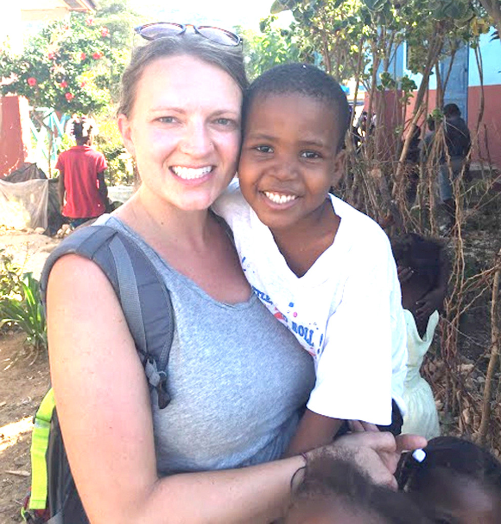"HALEY WYATT says a young boy affectionately-known as ""Bebe"" played a huge part in her falling in love with Haiti and its people. Wyatt, who teaches at Northside Elementary and Woodford County High School, went on her first mission trip to Haiti in June 2014 with a group from Midway Baptist Church. (Photo submitted)"