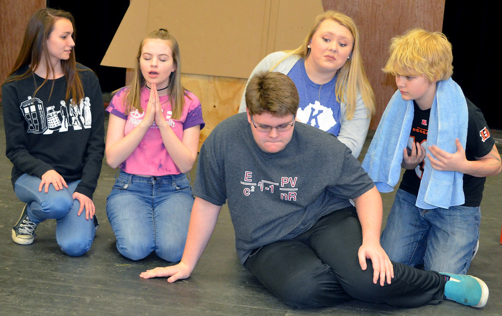 "CONNOR AKERS, pictured in front, portrays Charlie Brown in the upcoming production of ""You're a Good Man, Charlie Brown,"" at Woodford County High School. Also pictured, from left, are Jaid Goh (Snoopy), MaKenna Henehan (Sally), Abby Potts (Lucy) and Jonah Crockett (Linus) during a recent rehearsal. (Photo by Bob Vlach)"