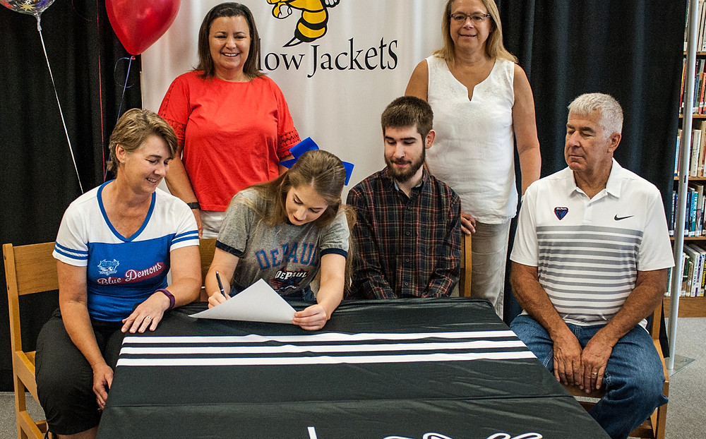 WCHS GRADUATE Sierra Brosius has signed with the DePaul University Blue Demons Cheer team. Front row, from left, are mother Cindy Brosius, Sierra Brosius, brother Sam Brosius, and father John Brosius; back row, former cheer coach Terri Morford and current Woodford coach Heidi Hemlepp. (Photo by Bill Caine Photography, www.billcaine.com)