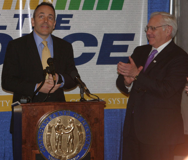 GOV. MATT BEVIN, left, praised KCTCS schools and defended his budget Thursday, Feb. 18, during a KCTCS rally in the Capitol rotunda. KCTCS president Jay Box, right, later noted that the governor didn't mention cuts made to the system in the seven years before Bevin took office. (Photo by John McGary)