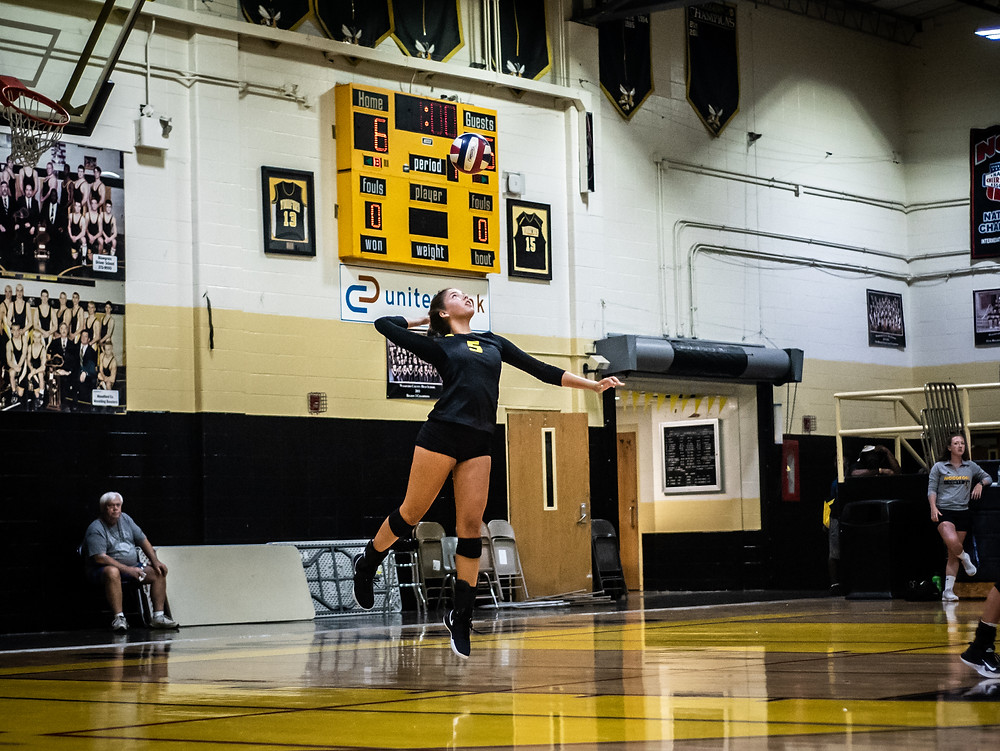 WCHS SOPHOMORE PIPER MCCOUN serves a point in the Lady Jackets' win over Owen County Aug. 22 at the Hive. (Photo by Bill Caine)