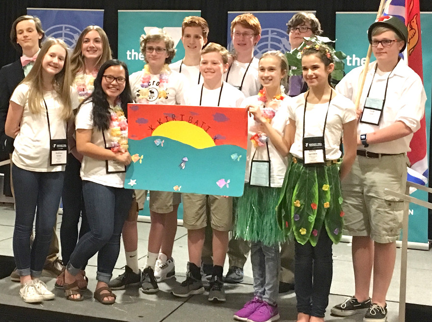 A DELEGATION OF STUDENTS from Woodford County Middle School represented the Republic of Kiribati at the Kentucky United Nations Assembly in Louisville on March 19, 20 and 21. From left are student-ambassadors Lucas Jones, Madison Ryker, Meghan Denton, Dorrah Martin, Garret Cheek, Mason Mefford, Will Dowdell, Cayce Jones, Julia Hill, Bryan Birch, Emelia Sprinkle and David Clark. (Photo submitted)
