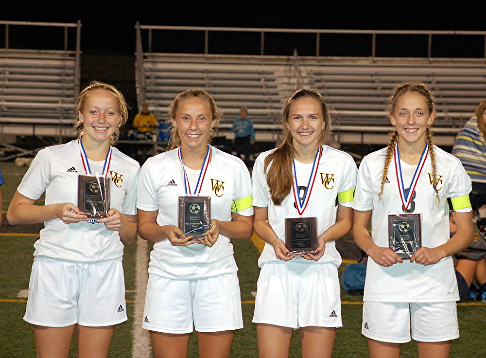 ALL DISTRICT AND MVP HONORS. Three players from the WCHS girls' soccer team were named to the 41st All-District Team. They were, from left, Shelbi Morrison, Lauren Rankin and Camryn Pictor, while MVP honors went to Caitlyn Burdine (far right). (Photo by Rick Capone)