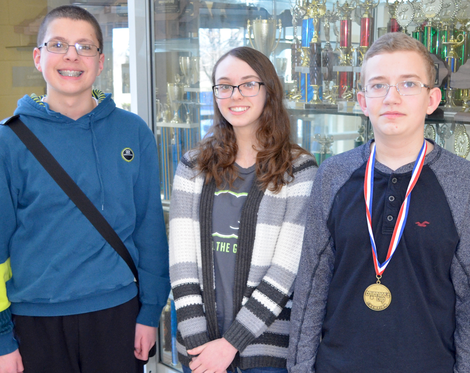 ADVANCING TO STATE FINALS in Kentucky Governor's Cup written assessment were, from left, Woodford County Middle School eighth-graders Trevor Wells (social studies), Avery Schanbacher (language arts) and Keaton Martin (arts and humanities). (Photo by Bob Vlach)