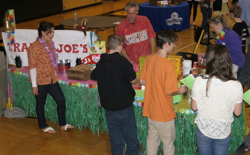 TRADER JOE'S seemed to be the most-visited table at Woodford County Middle School's Career Day last Friday, but the author of this column attributes that to all the goodies they gave away. (Photo by John McGary)