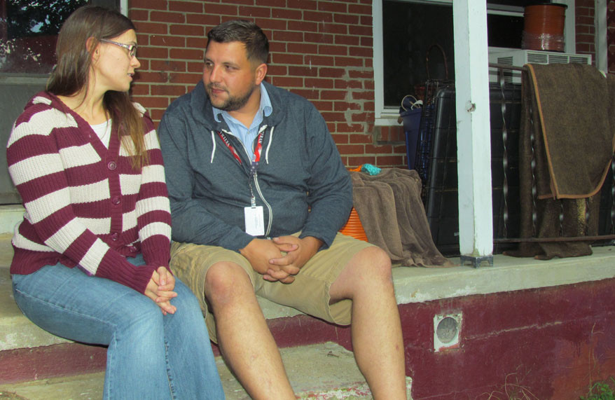 THREE DAYS AFTER a fire badly damaged their home, Tabitha and David Nichols sat on the back porch of their Kilmer Street house and talked about what's next – and how touched they are by the community's support. (Photo by John McGary)