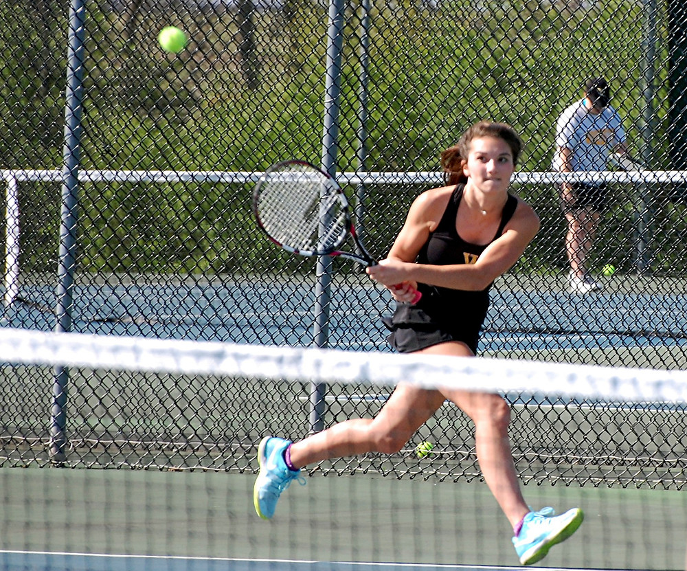 REAGAN JOBE stretches to make a backhand shot during the Woodford County High School girls' tennis match at home against Lafayette on Monday, April 10. Jobe won her singles match 8-5 to help her team get a 5-3 win over the Generals. (Photo by Rick Capone)