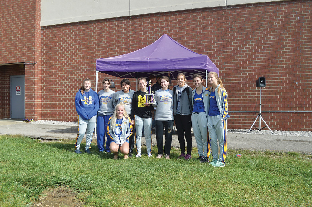 THE MIDWAY UNIVERSITY WOMENS' CROSS COUNTRY TEAM  poses with first place trophy at the Asbury Invitational. Pictured from left: Cassie Fryman, Josette Isaacs, Nataly Gonzalez, Rachelle Felski, Julia Sammet, Emily Chandler, Madeline Segars and Ann Oakley. Kneeling in front, Pippa Asherwood. (Midway University Athletics photo)