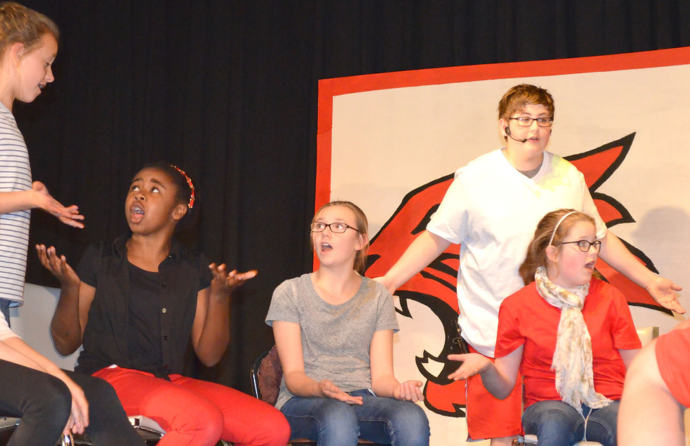 "ANN SOPHIE MARTIN, Myrion Campbell, Caroline Wells, Bryan Birch and Allie Glockner, pictured left to right, rehearsed a scene from ""High School Musical JR."" last week. Performances at the Woodford County Middle School cafeteria are Thursday, May 26, and Friday, May 27, at 7:30 p.m. Tickets are $5 for adults and $3 for students. (Photo by Bob Vlach)"