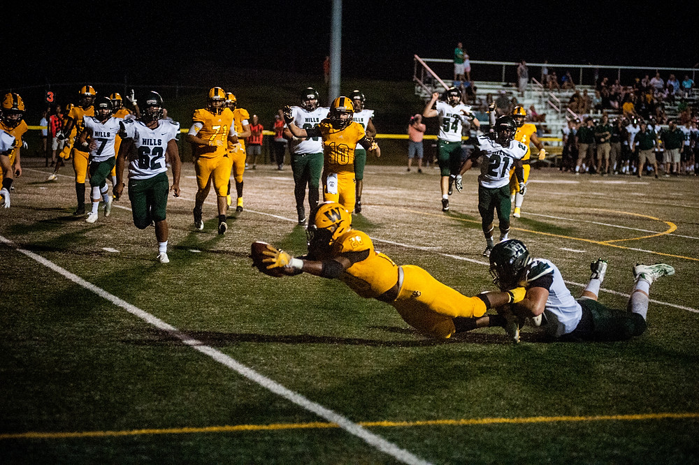BRENNAN CLARK dives for a touchdown in the fourth quarter against Western Hills on Friday, Sept. 22, at Community Stadium. (Photo by Bill Caine)