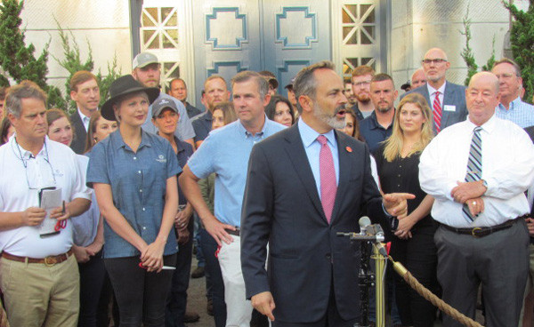"""GOV. MATT BEVIN headlined the grand opening of Castle & Key Distillery Wednesday, Sept. 19, saying, """"What an incredible, incredible place."""" From left, cofounder Will Arvin, master distillery Marianne Eaves, cofounder Wes Murry, Bevin, and Woodford Judge-Executive John Coyle. (Photo by John McGary)"""
