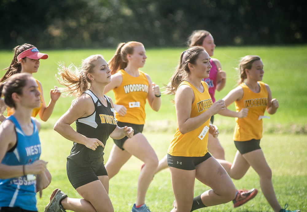 THE WCHS GIRLS' CROSS COUNTRY TEAM placed fifth at the Woodford County Invitational Saturday Oct. 5 at Falling Springs. The Lady Jackets had an average time of 27:47.42. (Photo by Bill Caine)