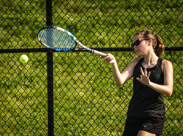 ADDIE PATTERSON and teammate Cassidy Stiefel lost in a third-set tiebreaker at the state tournament June 1. The duo was among the youngest in the tournament. (Photo by Bill Caine)
