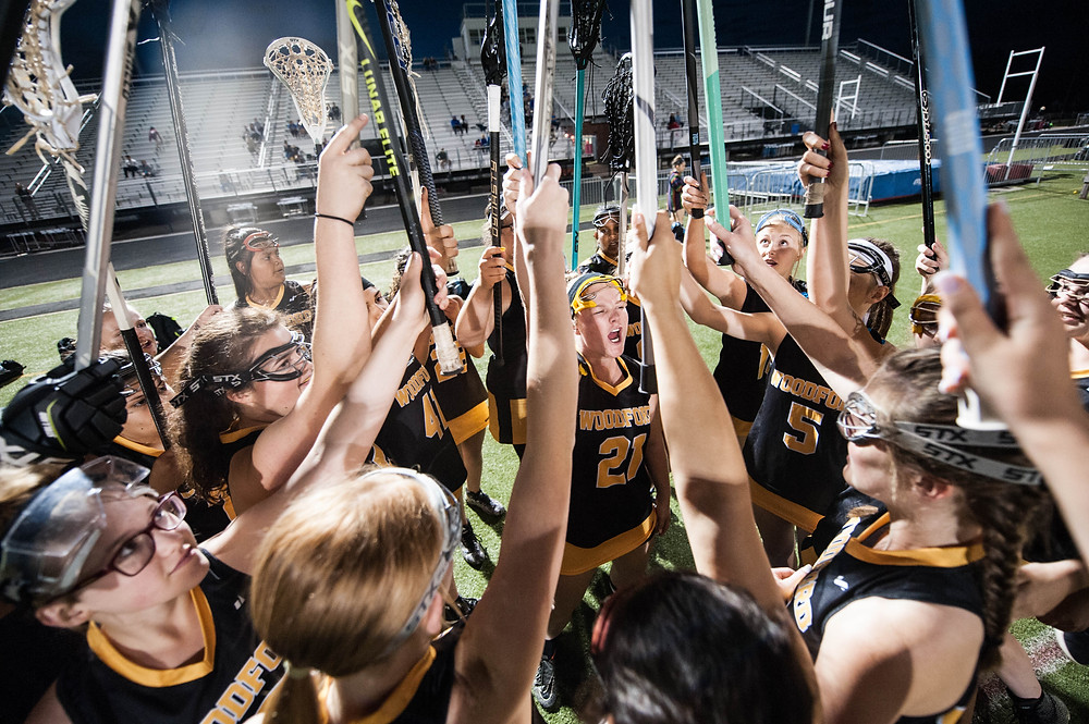 THE LADY JACKETS prepare to take the field moments before playing Henry Clay on April 22, at Lafayette High School. Woodford County beat Henry Clay, 18-3 and remain undefeated this season. (Photo by Michael Muncy)