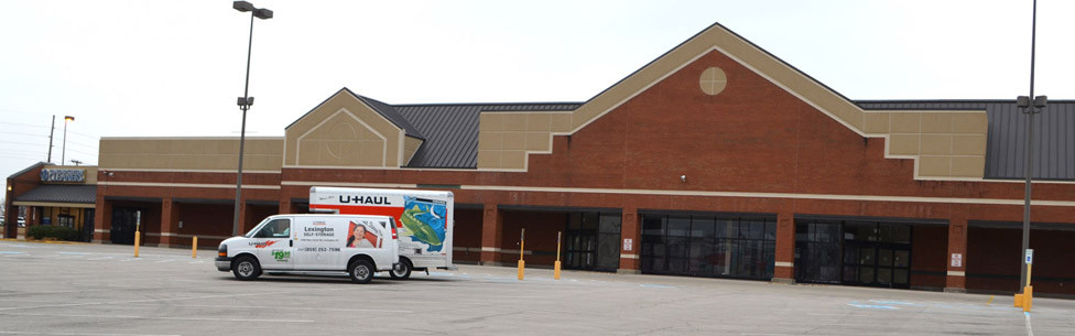 A U-HAUL TRUCK and van were parked outside of the former storefront of Kroger in the Lexington Road Plaza last Thursday. U-Haul wants to open a self-storage and rental facility in the shopping center, but has not yet had any plans approved for an adaptive reuse of the former Kroger or Kmart buildings. (Photo by Bob Vlach)