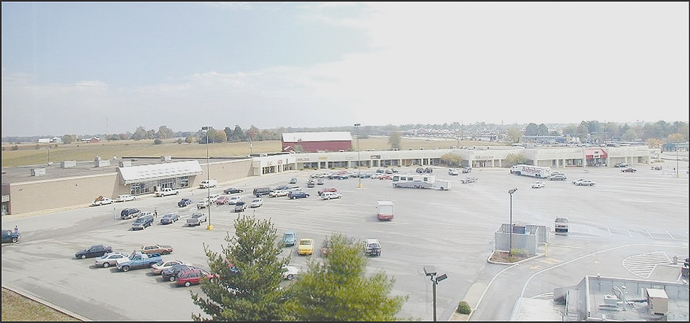 THE SITE of the old Versailles Center on the U.S. 60 Bypass at Lexington Road will be the location for an 81-room Holiday Inn Express and Suites and, thanks to an agreement between McDonald's and the site's current owner, perhaps two more restaurants. This photo was taken from the fifth floor of the United Bank building in September 1999. The center's buildings were razed by the City of Versailles in 2014. (File photo by Stephen Peterson)
