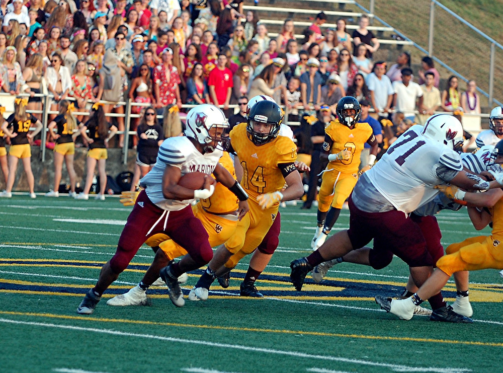 MAX ANDREONI, No. 14, tries to get the angle on the runner from Marion County in the Woodford County High School football team's home game on Friday, Sept. 9. While the Knights took an early two touchdown lead, the Yellow Jackets came back to win the game 32-20. (Photo by Rick Capone)