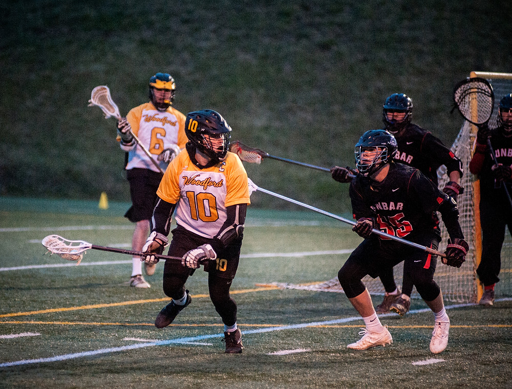 WCHS SENIOR BRODY MCCOUN handles the ball in the Jackets' loss to Dunbar on Friday, March 9 at Falling Springs. McCoun leads the team with 18 goals on the season. (Photo by Bill Caine)