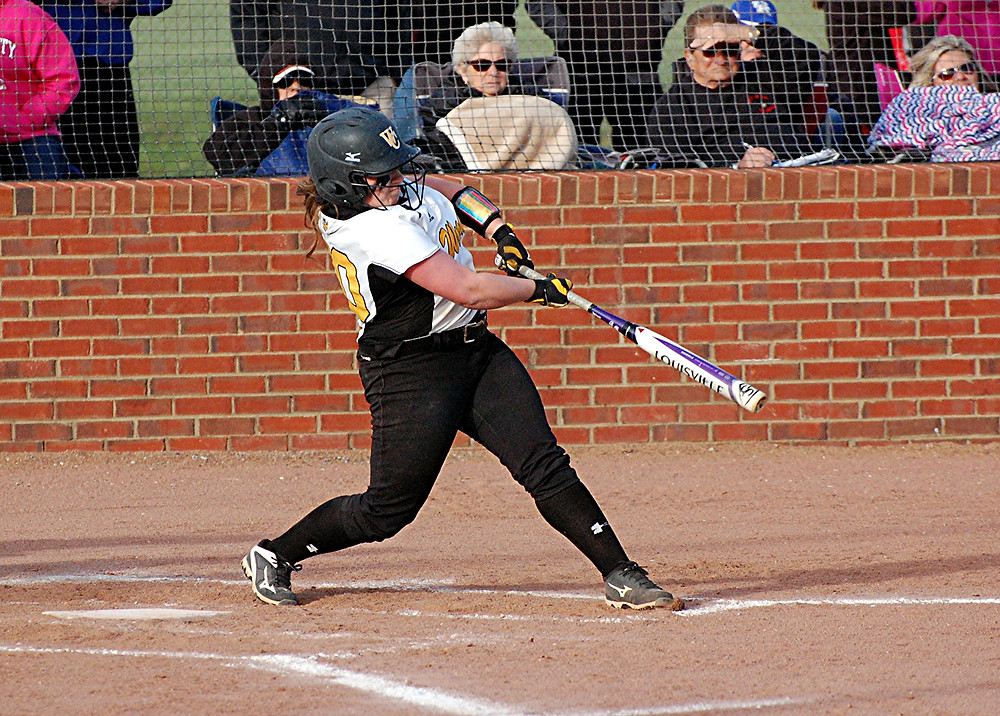 PAIGE HAMPTON hit a home run on this swing to give the Woodford County High School softball team a 4-0 lead over No. 3 Scott County at the start of the second inning in the team's season opener at home on Tuesday, March 22. However, despite Woodford's best efforts, the Lady Cardinals came back to win the game 7-6. (Photo by Rick Capone)