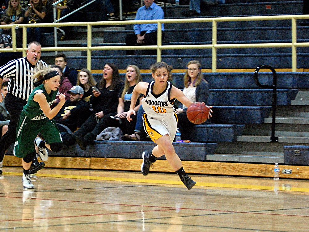 PEYTON ROSE brings the ball down the court on a fast break during the Woodford County High School girls' basketball district game against Western Hills at home in The Hive on Tuesday, Dec. 6. Rose led her team with 22 points to help the Lady Jackets win 73-56. (Photo by Rick Capone)