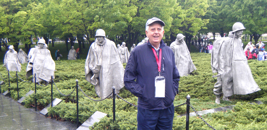 DON HAMPTON stood alongside the Korean War Memorial in Washington, D. C., on Saturday, April 22. Honor Flight Kentucky provides World War II, Korean War and Vietnam War veterans with all-expenses-paid chartered flights to D.C. so they can see the war memorials. (Photo by Guy Cornish)