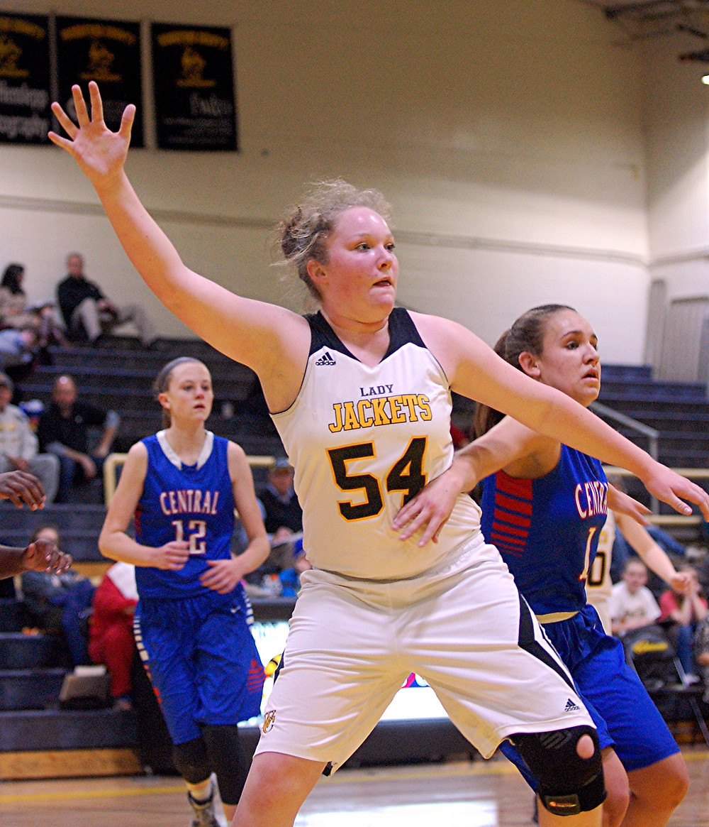 DELANEY ENLOW might be an eighth-grader on the Woodford County High School girls' basketball team, but at this point in the season, she has become a veteran varsity player. Against Madison Central at home on Thursday, Jan. 28, she had another double-double, scoring 16 points and pulling down 15 rebounds in the game. Despite her efforts, the Lady Indians were the better team on this night and won 58-44. (Photo by Rick Capone)