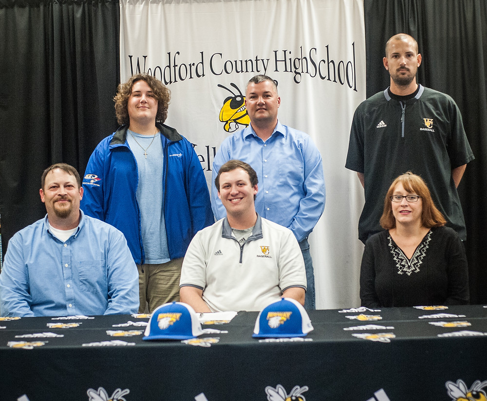 WCHS SENIOR COLLIN MURRAY signed his letter of intent with Midway University on Friday, May 4. Pictured from left: father Marty Murray, Collin, mother Aleisha Evans. Back : brother Trevor Evans, step-father Damon Evans and WCHS Coach Paul Patterson. (Photo by Bill Caine)