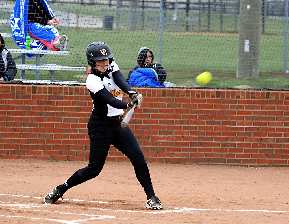 ABBY MOFFETT, a freshman on the Woodford County High School softball team, blasted this ball over the center-field fence for a home run during Woodford's season- and home-opener on Monday, March 13. For Moffett, the home run happened on her first at-bat with the high school team and helped the Lady Jackets defeat Henry Clay 16-0 in a four-inning, mercy-rule victory. (Photo by Steve Blake/multiexposures.com)