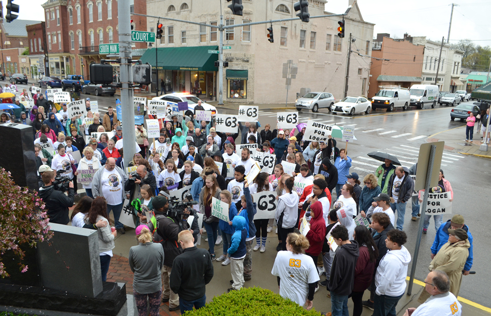 A MOMENT OF SILENCE was held outside the Woodford County Courthouse Tuesday to remember Logan Tipton, who was stabbed to death in his family's Versailles home in December 2015. Family members and others in the community participated in a march to the courthouse prior to Ronald Exantus being sentenced to 20 years in prison for three counts of assault. The Indiana man was found not guilty of murdering 6-year-old Logan by reason of insanity. (Photo by Bob Vlach)