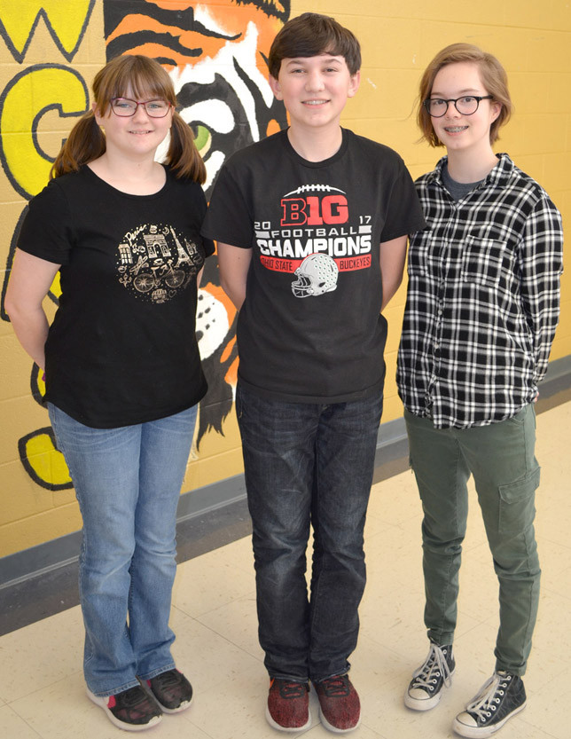 ADVANCING TO STATE in written assessment were Woodford County Middle School eighth-grade students, from left, Reida Harrod (language arts), Bryant Craig (science) and Maia Smith (arts and humanities). (Photo by Bob Vlach)
