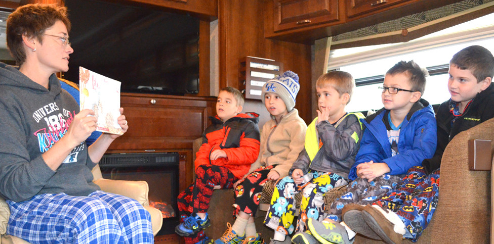 "PRINCIPAL CARA MEADOWS read to Woodford Christian School kindergarten students, from left, Fletcher Branham, Lucas Gaunce, Will Cummins, Alex Czarapata and Logan Stout during ""Read Your Heart Out Day in November 2014. (File photo by Bob Vlach)"